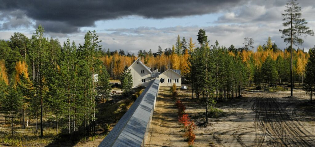 ZOTTO pergola leading to house and bunker in autumn with yellow birches in the back
