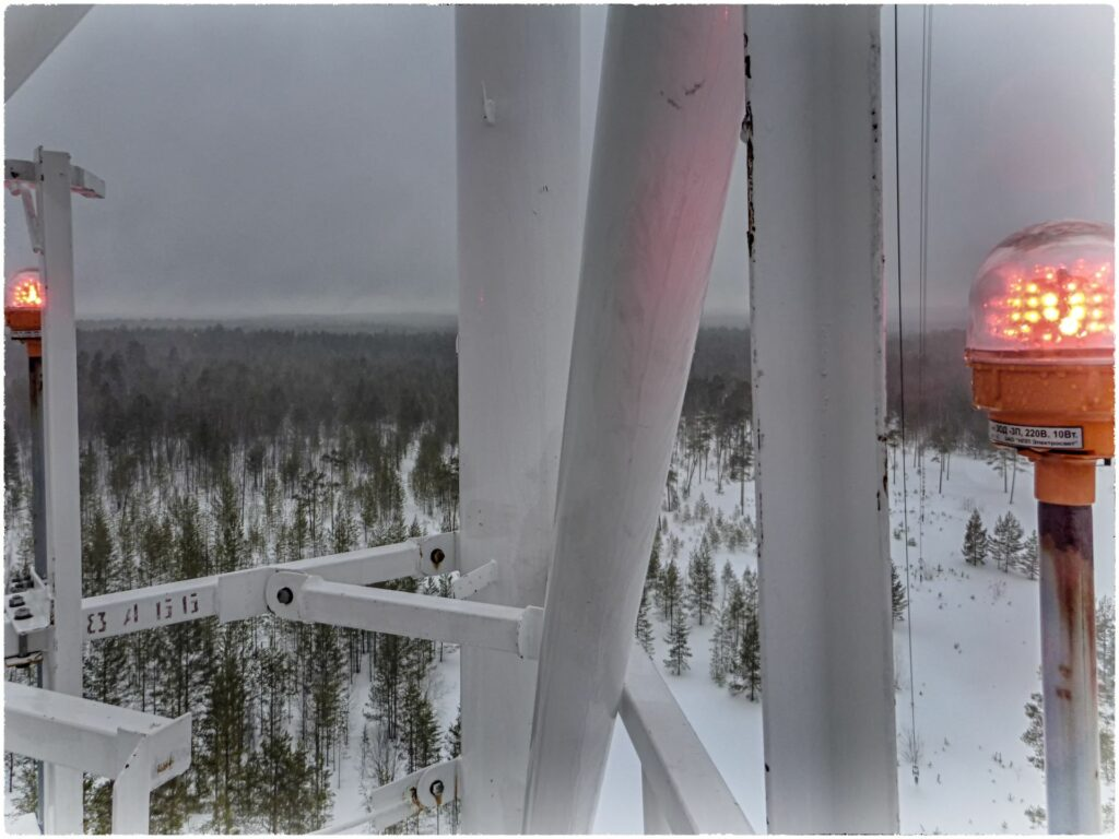 view from the tower in cold and wet winter weather and red signal lamp