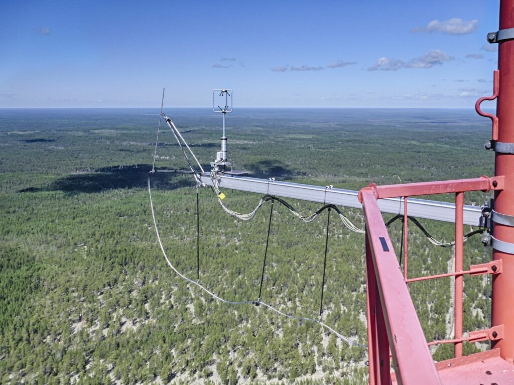 gigantic view into the distance from the top of the Tall tower with 3-D-anemometer and gas inlet to the horizon