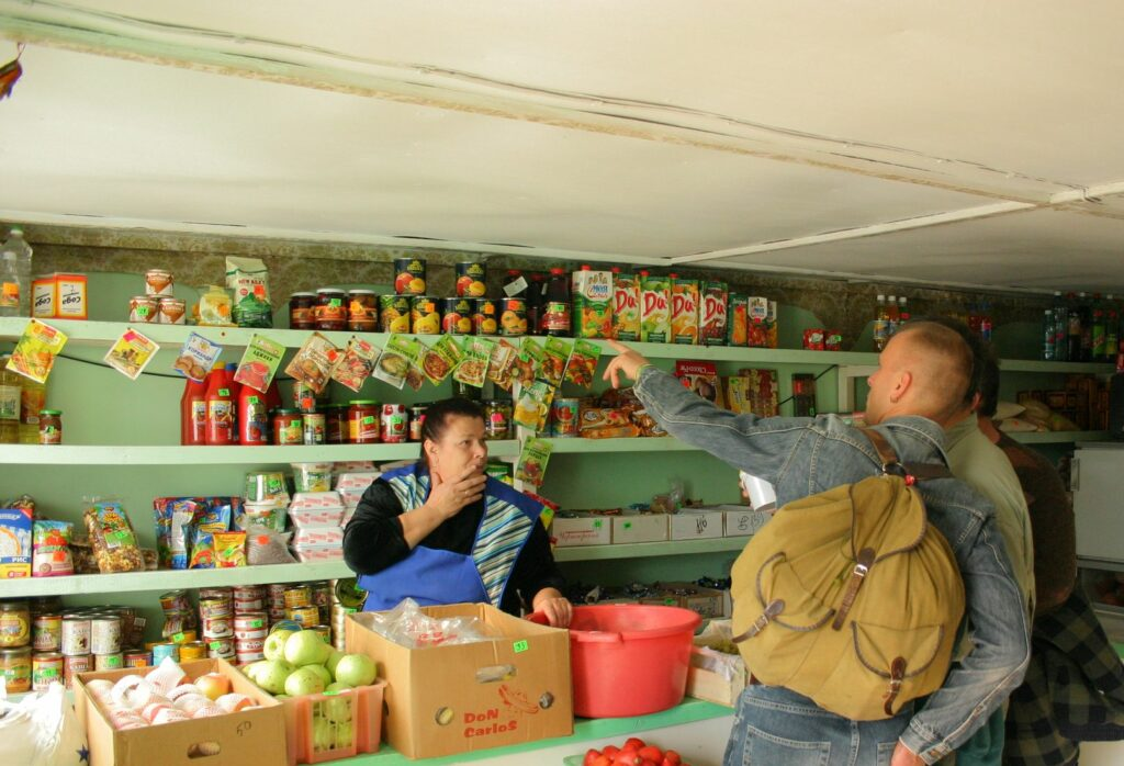 Travelers shopping in small siberian kiosk