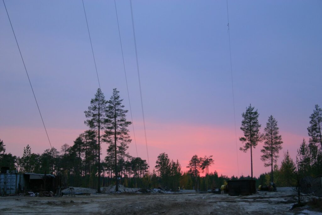 Tensioning cables of the tall tower before pink sky in Zotto