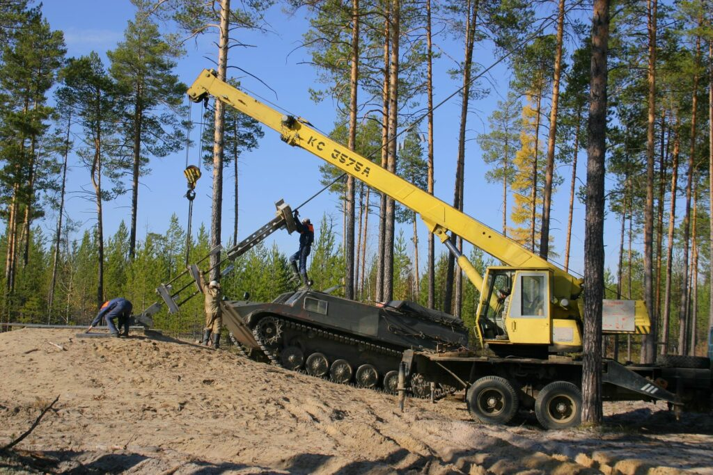 excavator and armour while fixing the bracing