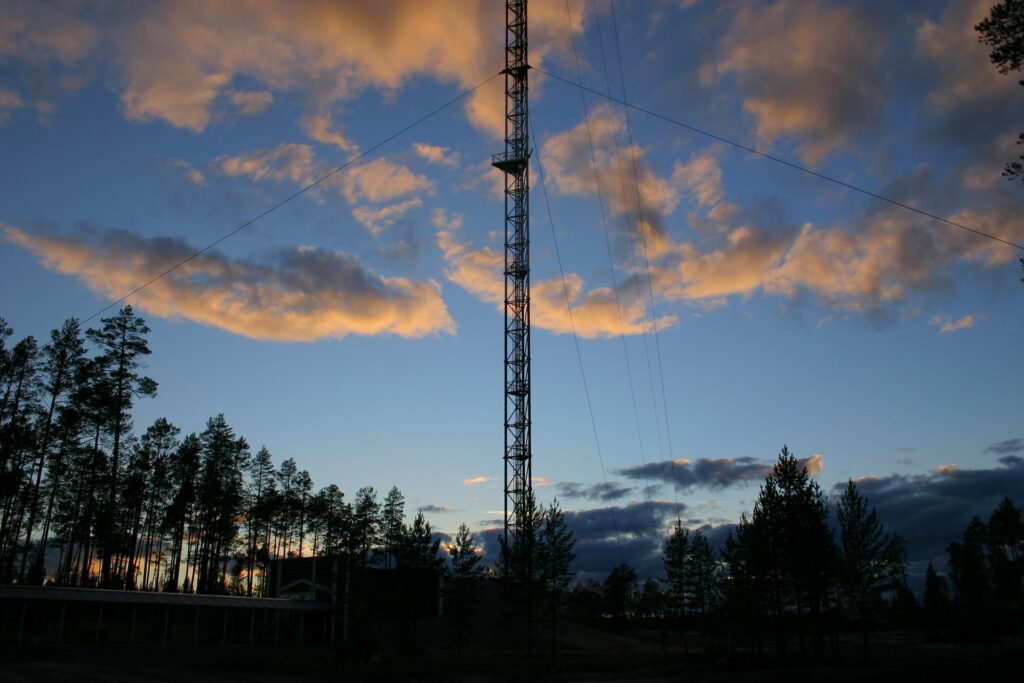 Zotto tower in the evening with orange clouds