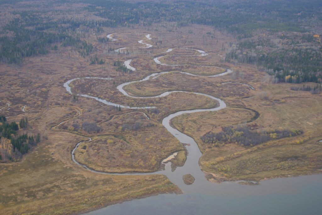 view from airplane on meandering tributary to the river Jenssei in autumn